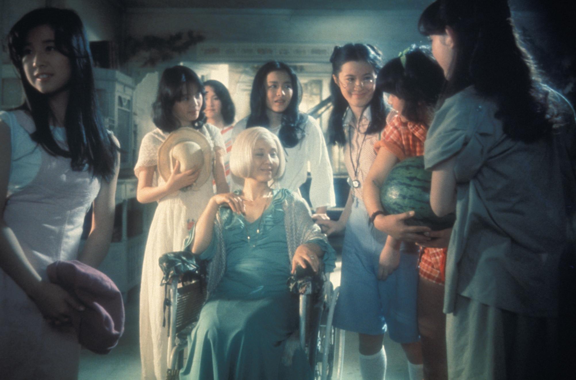 """The cast:  Kumiko Oba (""""Fantasy""""), Masayo Miyako (""""Sweet""""), Eriko Tanaka (""""Melody""""), Kimiko Ikegami (""""Gorgeous""""), Ai Matsubara (""""Prof""""), Mieko Sato (""""Mac""""), Miki Jinbo (""""Kung Fu""""); seated: Yoko Minamida (""""Gorgeous's Aunt"""")"""