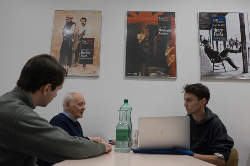 Artiom Sopin and Naum Kleiman talk with Patrick Holzapfel in the Film Museum's  library.