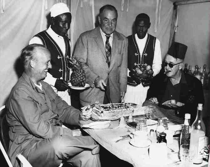 Wingate Smith having fun on the set of Mogambo (1953) with cameraman Robert Surtees & John Ford